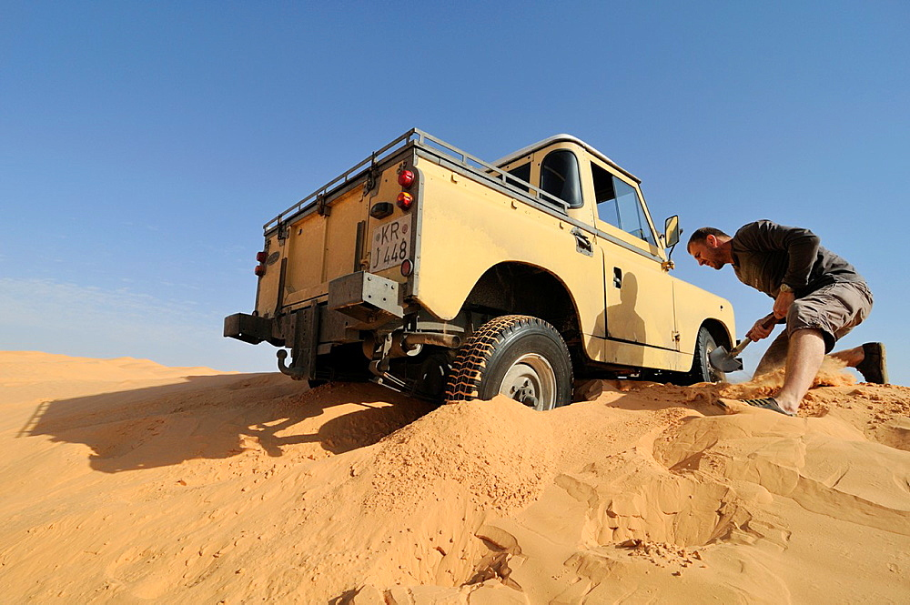 Africa, Tunisia, nr Tembaine Desert traveller got stuck with his 1964 Land Rover Series 2a Truck Cab while traversing sand dunes close to Tembaine on the eastern edge of the Grand Erg Oriental in the Sahara desert