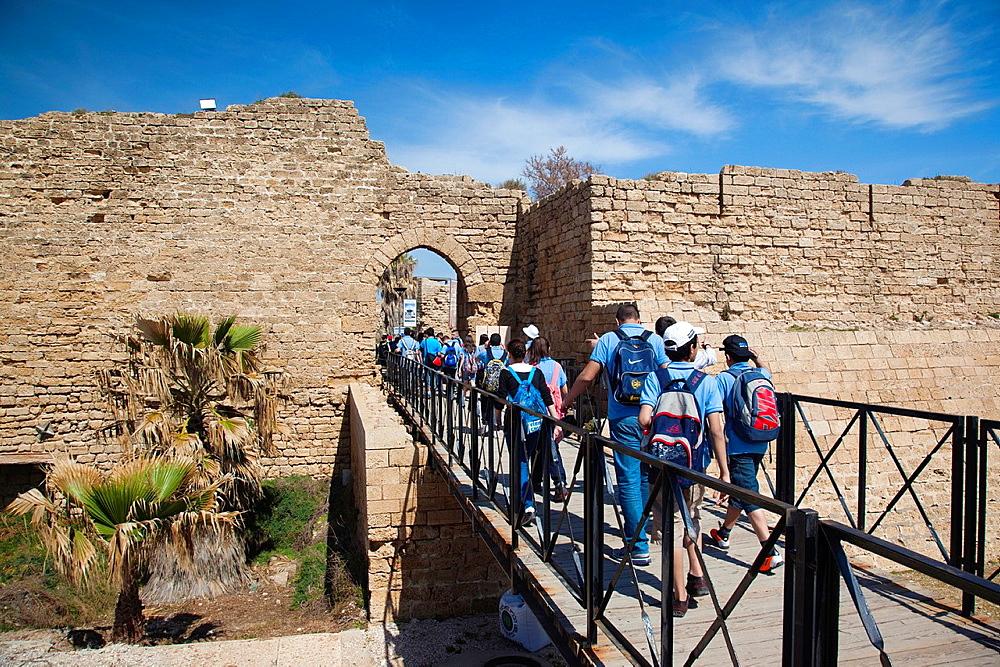 Israel, North Coast, Caesarea ruins of port built by Herod the Great in 22 BC, schoolchildren