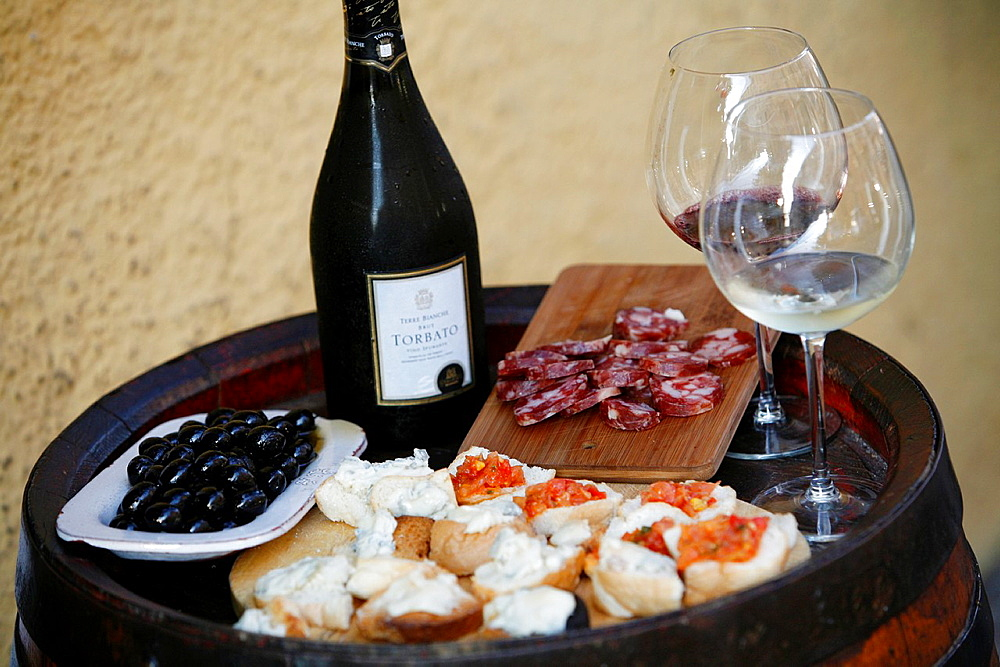 Plate of cheese, salami, olives and wine at Osteria Da Lio, La Maddalena, Sardinia, Italy
