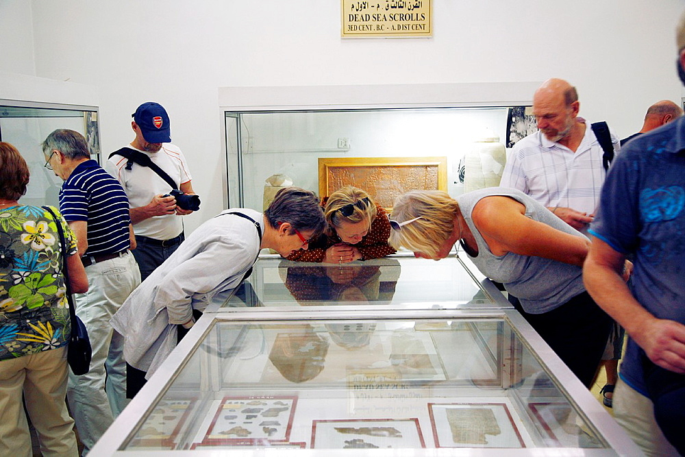 Tourists looking at the Dead Sea Scrolls at the National Archeological Museum in the Citadel, Amman, Jordan