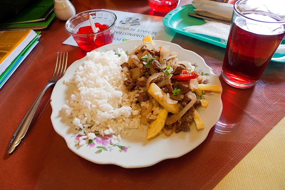 Typical Peruvian food 'Lomo Saltado' Stewed Beef with Tomatoes with rice Cusco, Peru