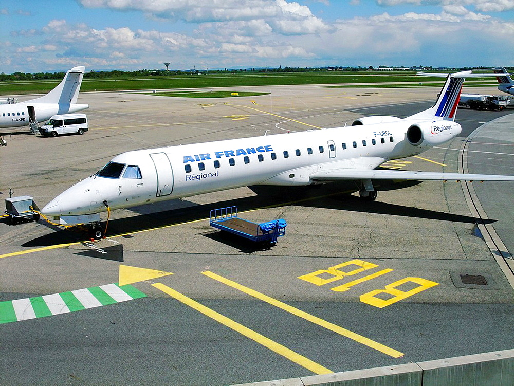Embraer ERJ-145 regional jet of the company Regional (flying for Air France) on the parking at Lyon Saint Exupery airport, France