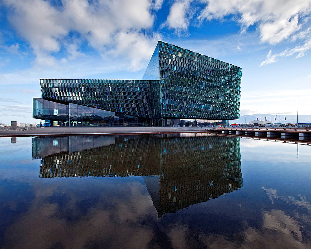 Harpa Concert Hall and Conference Center, Reykjavik Iceland Situated on the boundary between land and sea, the building is a gleaming sculpture reflecting both sky and harbor The glass facade was designed by Olafur Eliasson in collaboration with Henning. Harpa Concert Hall and Conference Center, Reykjavik Iceland Situated on the boundary between land and sea, the building is a gleaming sculpture reflecting both sky and harbor The glass facade was designed by Olafur Eliasson in collaboration with Henning Larsen Architects in Denmark and Batteriid Architects in Iceland
