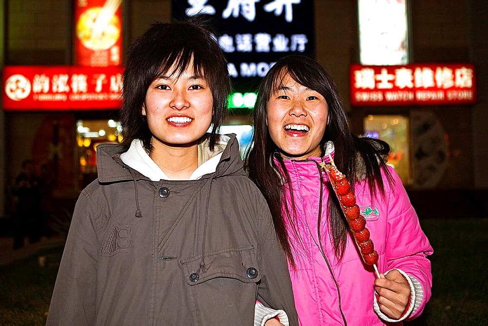 Friends in Wang Fu Jing street Is a Pedestrianized Shopping Street, Beijing, China