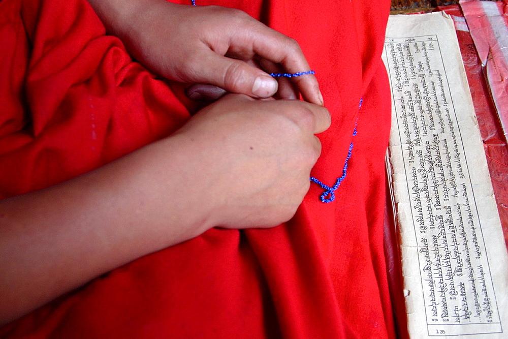 Child hands and the buddhist mantra, Bhutan