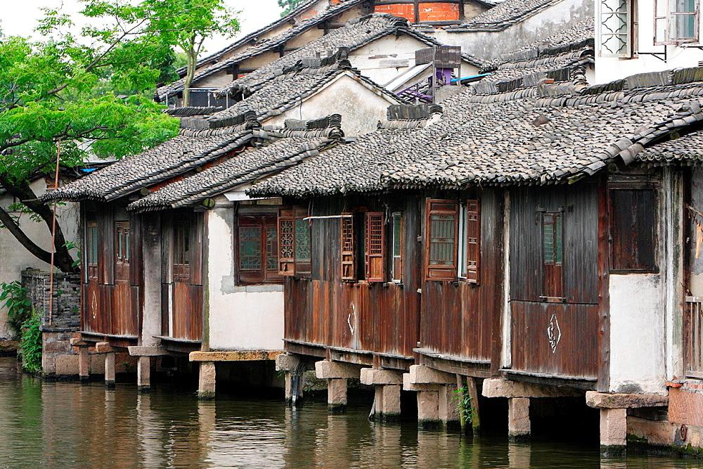 Traditional Chinese folk houses along a river in Wu Town, Zhejiang Province, old town of Wuzhen, Zhejiang, China