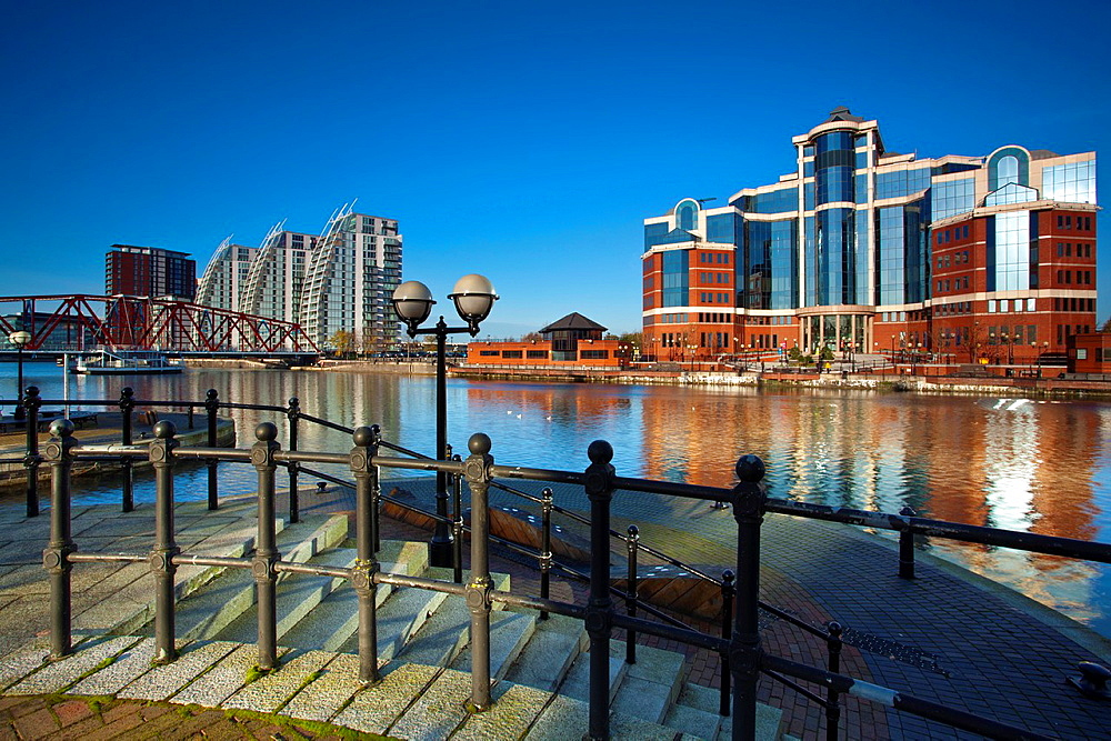 England, Greater Manchester, Salford Quays NV apartments, Detroit Bridge and Victoria Harbour building located along the Manchester Ship Canal in Salford