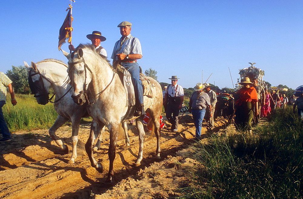 Pilgrims near Donana Palace,Romeria del Rocio, pilgrims on their way through the Donana National Park, pilgrimage of Sanl√∫car de Barrameda brotherhood, to El Rocio, Almonte, Huelva province, Andalucia