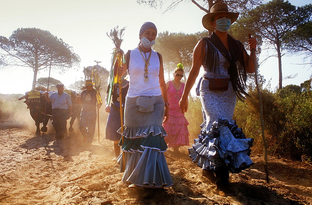 Pilgrims in El Cerro del Trigo,Romeria del Rocio, pilgrims on their way through the Donana National Park, pilgrimage of Sanl√∫car de Barrameda brotherhood, to El Rocio, Almonte, Huelva province, Andalucia