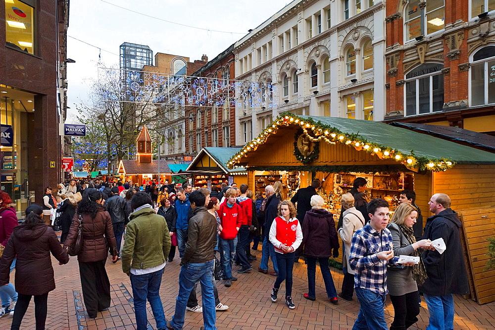 Crowds of last minute Christmas shoppers in front of Frankfurt German Christmas Market, New Street, Birmingham, UK