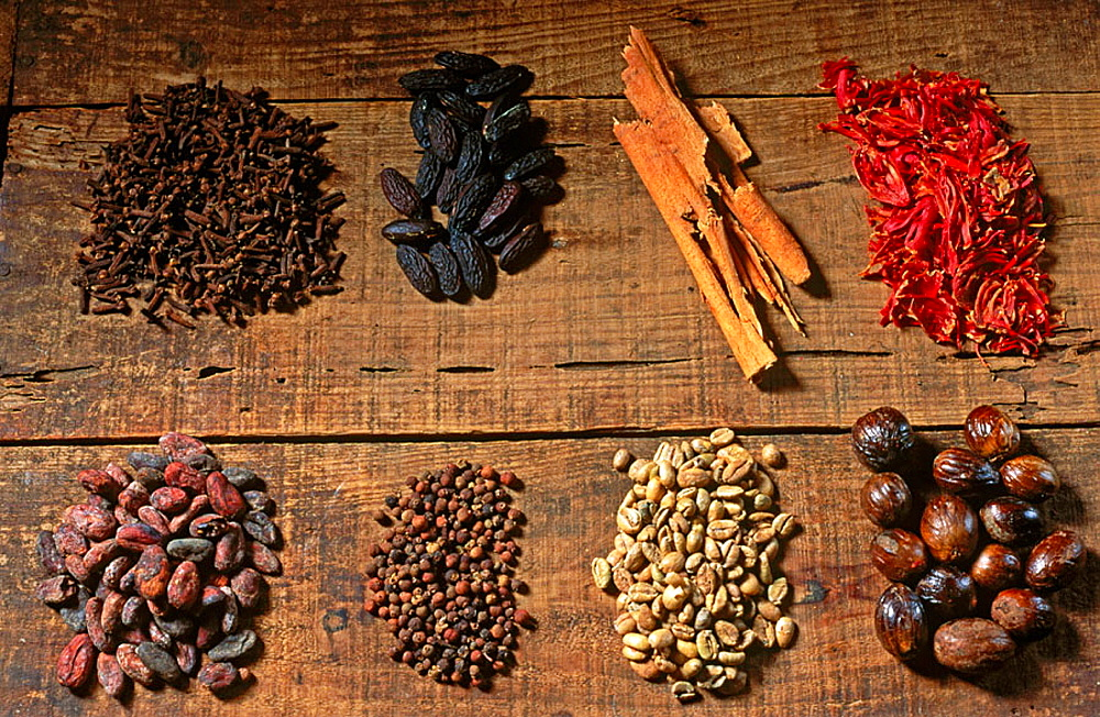 Food: (above, from left to righ) clove, tonka bean, cinnamon, mace; (below left to right) cacao, pepper, coffee, nut meg, Grenada