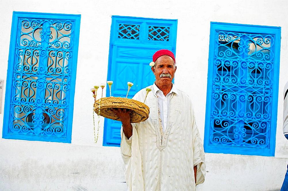 Jasmine seller, village of Sidi Bou Said near Tunis, Tunisia