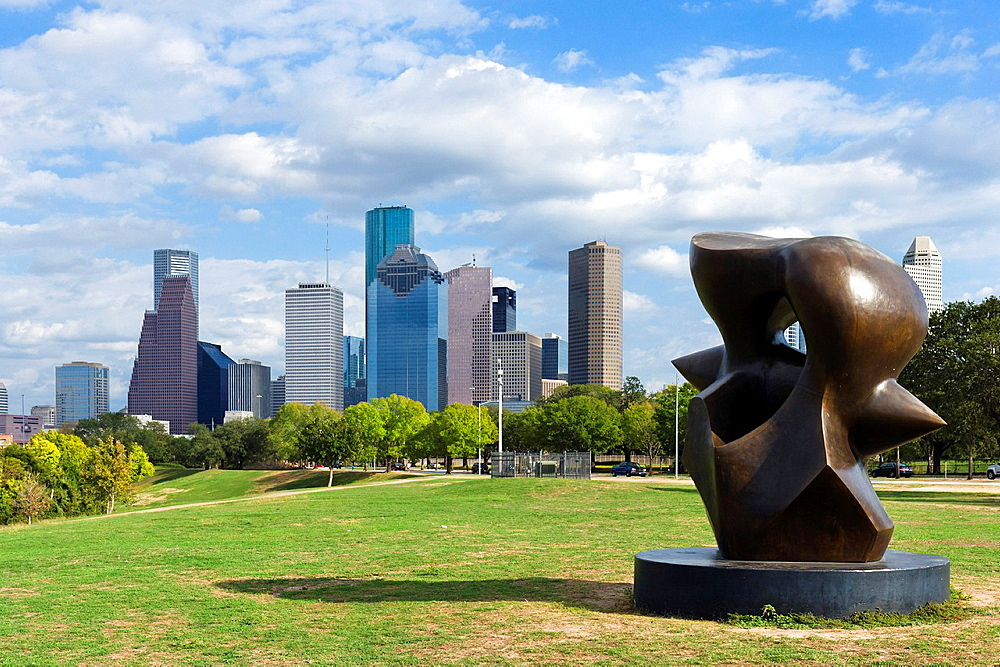 The city skyline from near Eleanor Tinsley Park with the Large Spindle Piece sculpture by Henry Moore in the foreground, Allen Parkway, Houston, Texas, USA