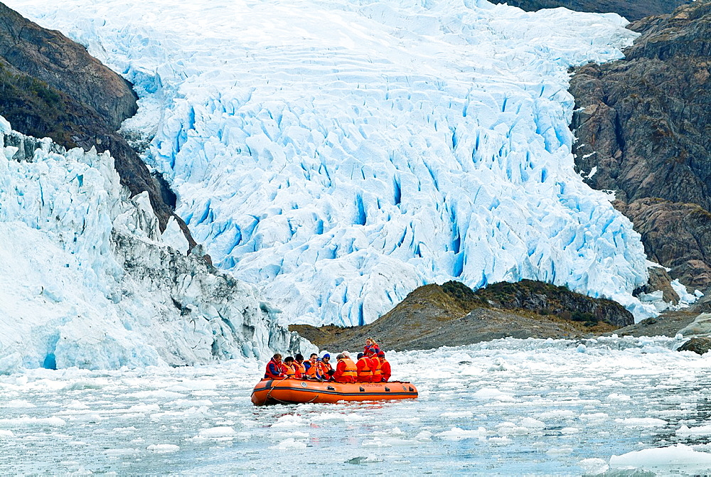 Tourtists exploring the fjords of Patagonia and Tierra Del Fuego, D´Agostini Glacier
