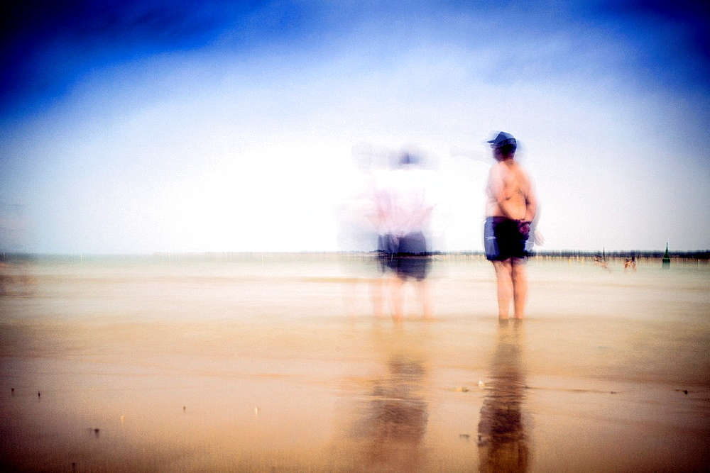 People on the beach, Sanlucar de Barrameda, Spain  Daylight long exposure shot by the use of neutral density filters