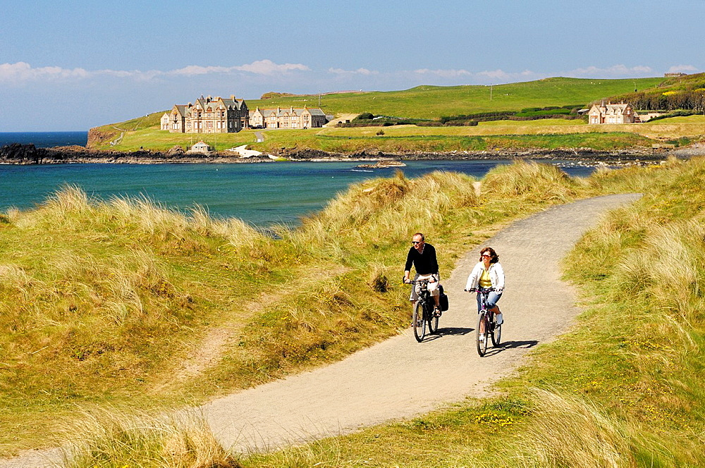 Cycling in sand dunes of Runkerry Strand, Portballintrae near Bushmills and Portrush, County Antrim, Northern Ireland  Summer