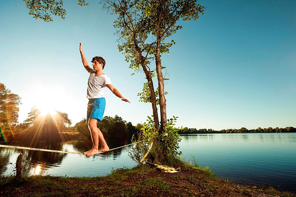 Man walking on tight rope outdoors