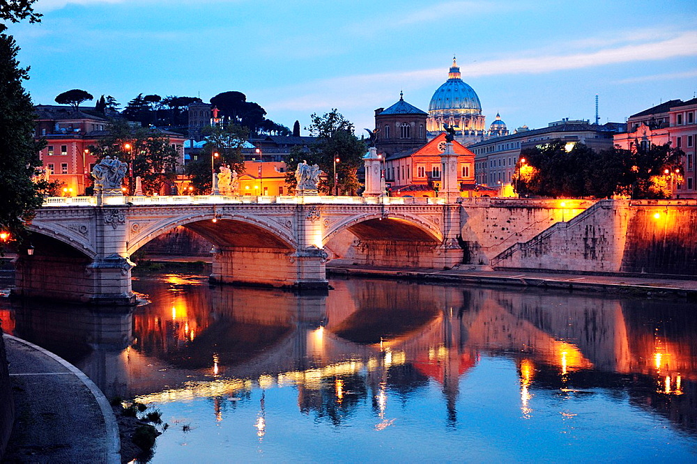 Santa´ Angelo Bridge and Basilica of St  Peter at night with the Vatican in the background in Rome, Italy