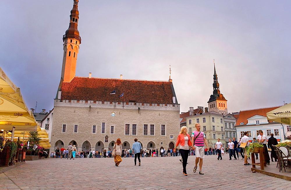Medieval town hall in Town Hall Square,at right belltower of St Nicholas church,Tallinn,Estonia - 817-406075