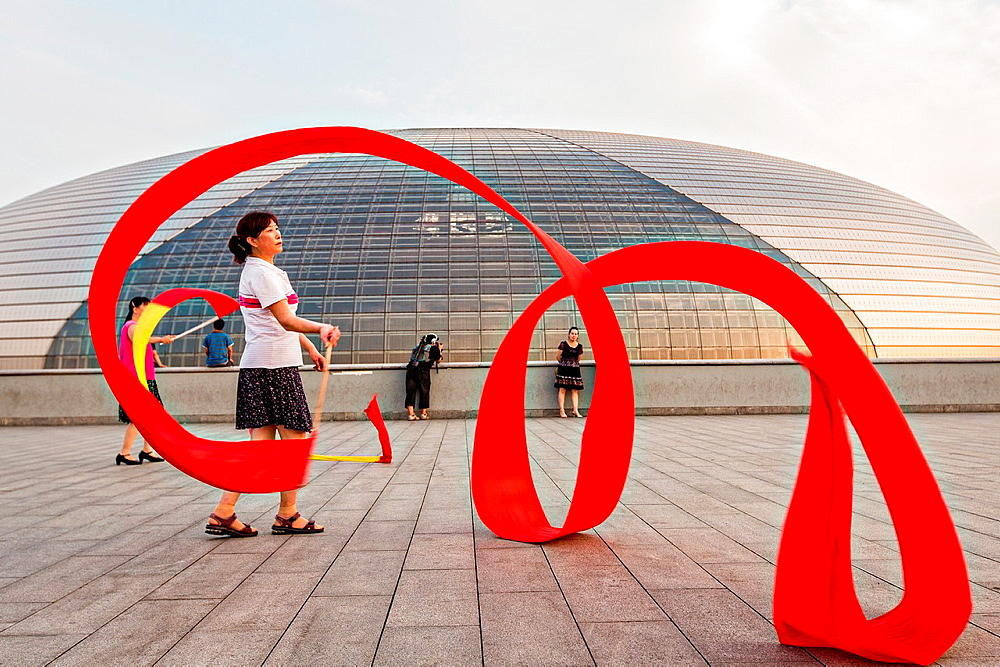 Women practice ribbon dancing at the National Centre for Performing Arts park in Beijing, China - 817-407491