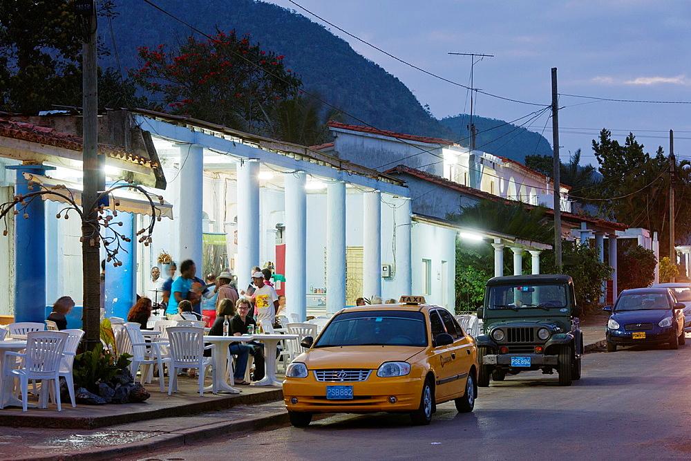 Cuba, Pinar del Rio Province, Vinales, Vinales Valley, outdoor cafe-bar, dusk