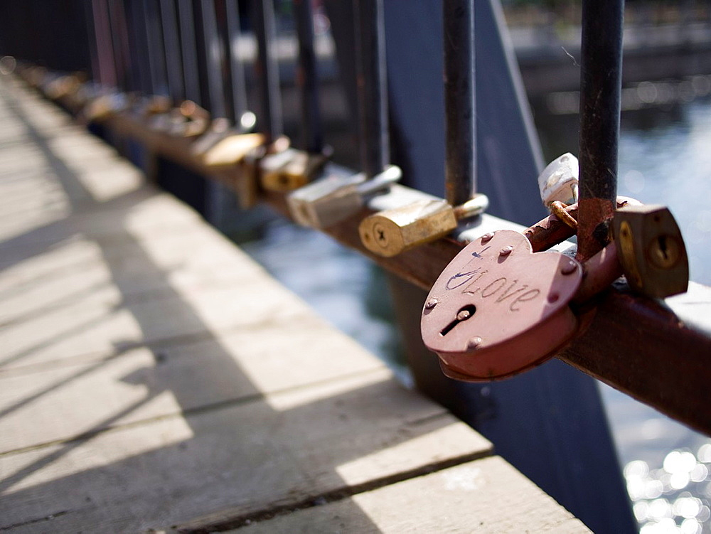 Locks left by romancing couples attached to bridge in accordance with local custom in Tampere, Finland