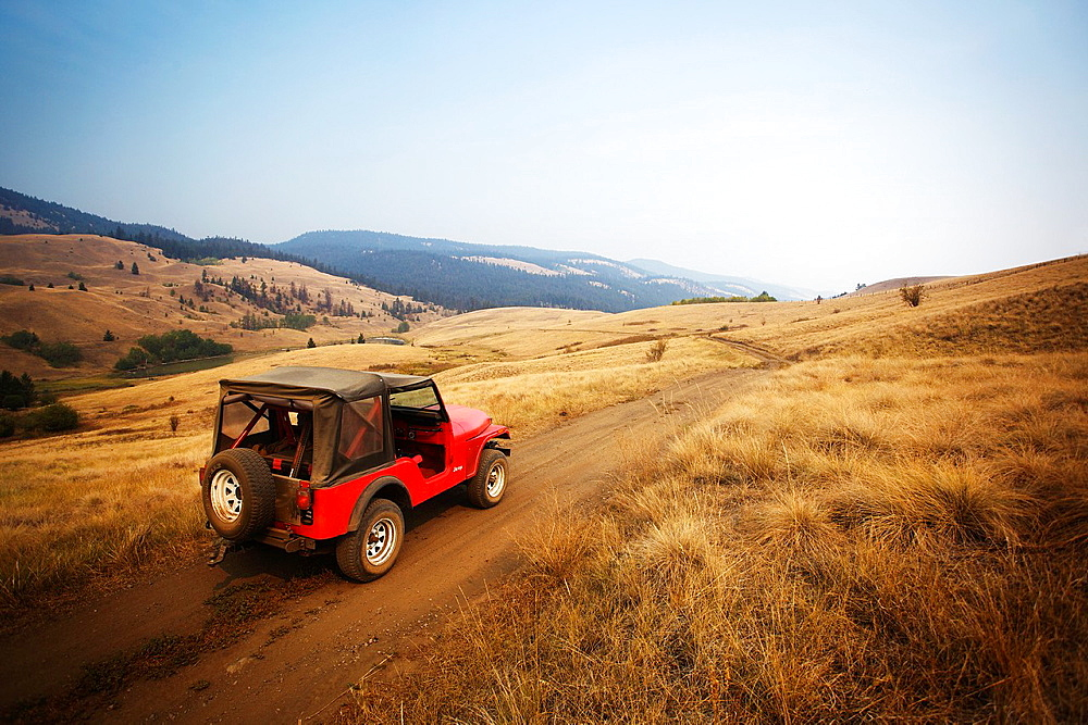 Red jeep going off road in Kamloops, British Columbia, Canada