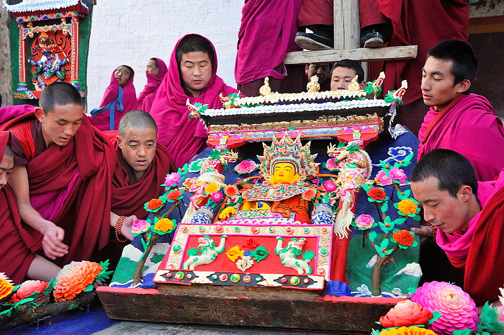 China, Gansu, Amdo, Xiahe, Monastery of Labrang Labuleng Si, Losar New Year festival, Monks bringing skilfully carved yak butter sculptures