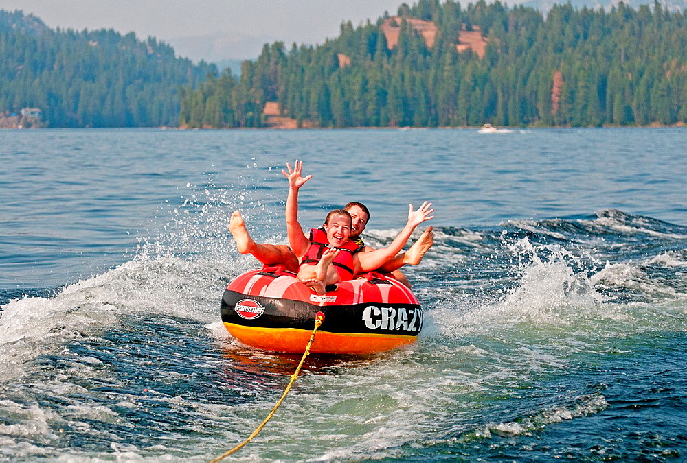 Elijah Weber and Nikki Tate riding the tube at Payette Lake near the city of McCall in central Idaho