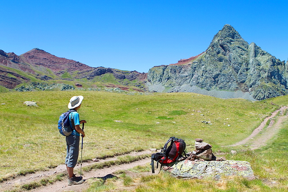 Hiker walking to Anayet peak, an old volcano in Tena valley Formigal Sallent de Gallego Pyrenees Huesca province Aragon Spain