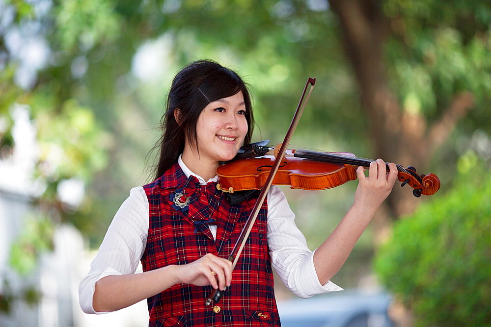 Female violinist at play in Puli, Taiwan.