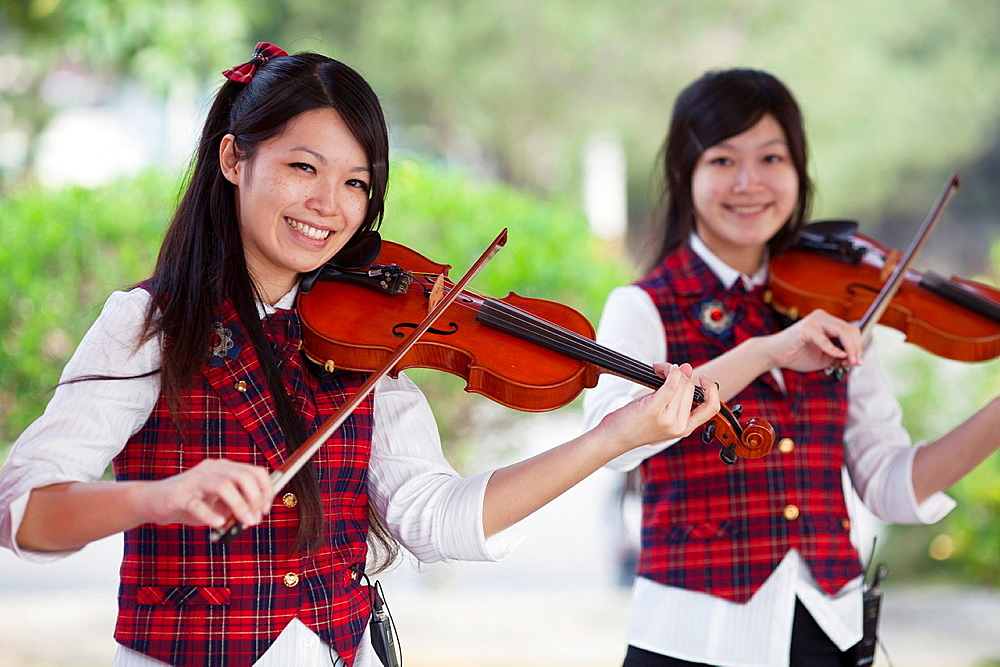 Female violinists at play in Puli, Taiwan.