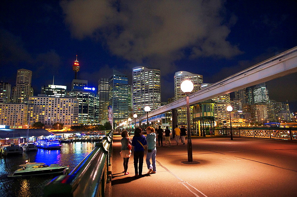 People Walking Across Pyrmont Bridge At Night, Darling Harbour, Sydney