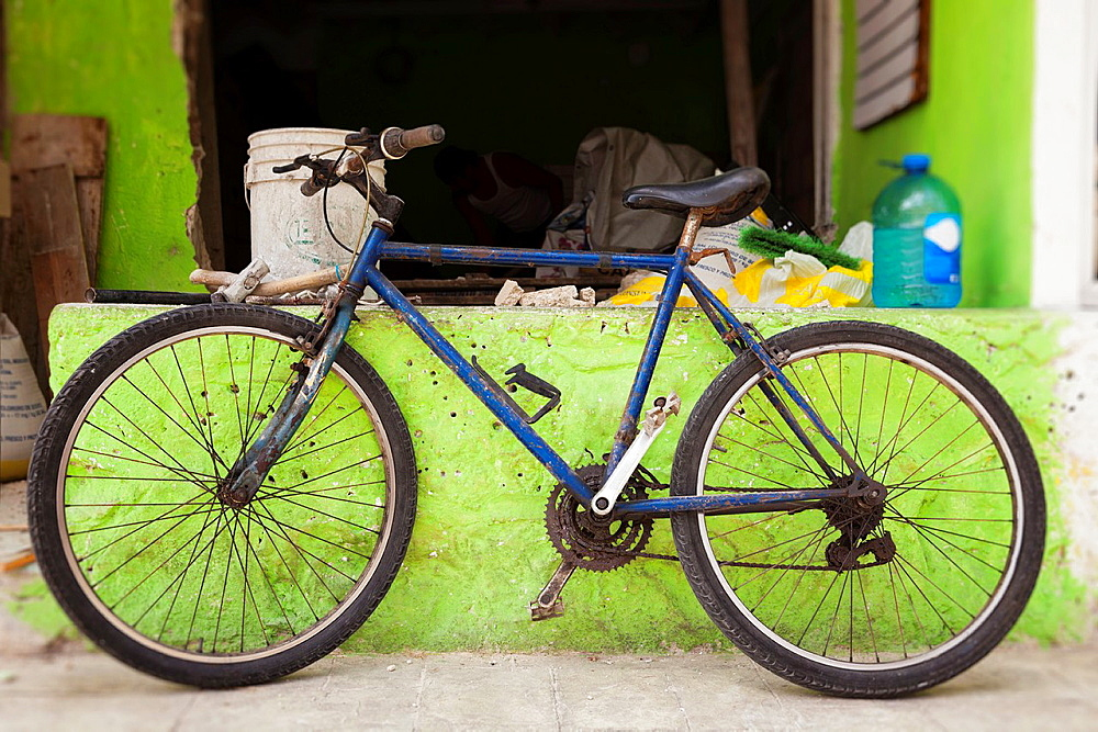 Bicycle leaning against green wall, Isla Mujeres, Yucatan Peninsula, Quintana Roo, Mexico