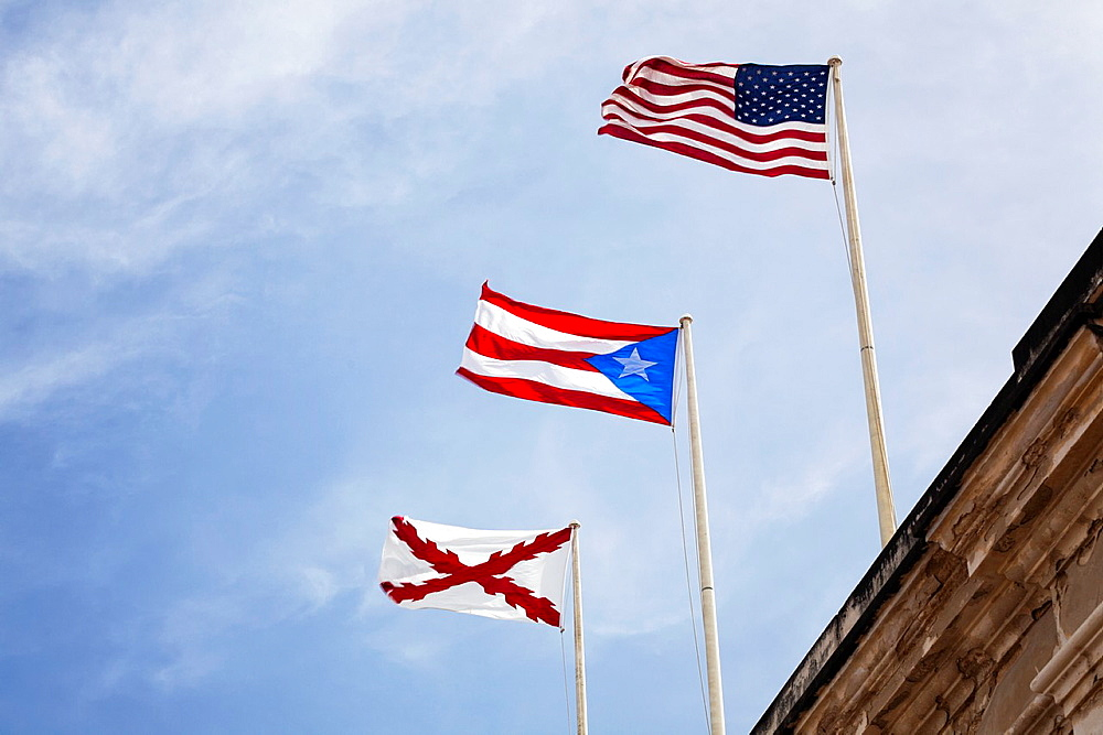 Puerto Rico, Old Spanish and USA flags fly over Fort San Cristobal, San Juan
