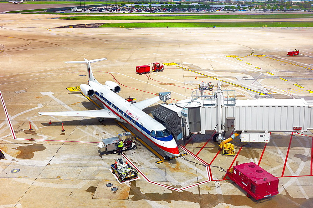 A docked American Airlines plane parked on the tarmac