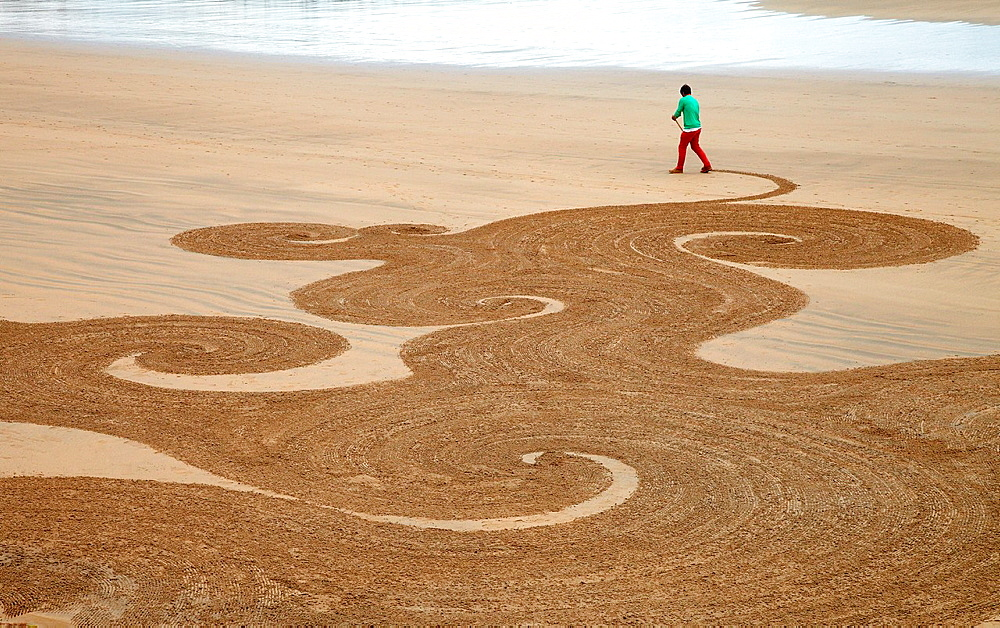 Sand drawing, Beach, Hendaye, Aquitaine, Pyrenees Atlantiques, France.