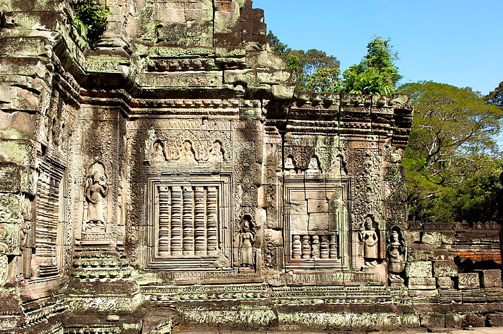 External wall adorned with bas-reliefs and a false window baluster, Preah Khan temple, Angkor, Siem Reap, Cambodia