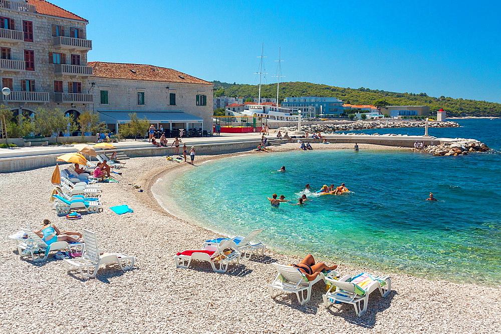 Tourists relaxing in Postira village on Brac island, Croatia