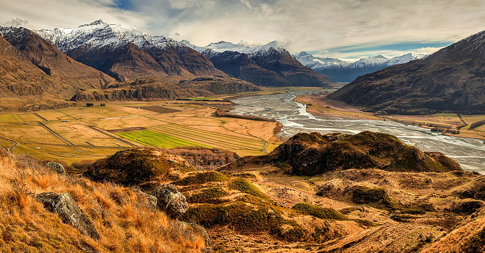 Panorama from tussock grass hills above Matukituki River, Black Peak left and Mt Aspiring right, near Wanaka, Otago