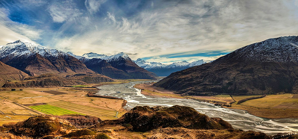 Panorama from tussock grass hills above Matukituki River, Black Peak left and Mt Aspiring centre, near Wanaka, Otago, near Wanaka, Otago