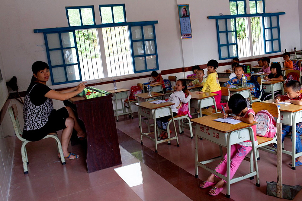Teacher and students in primary school in Jiexi, China.