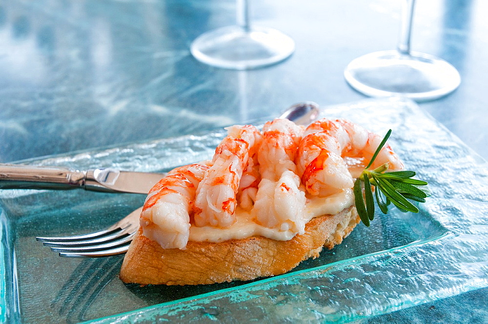 Spanish tapa: Prawns with alioli. Madrid, Spain.