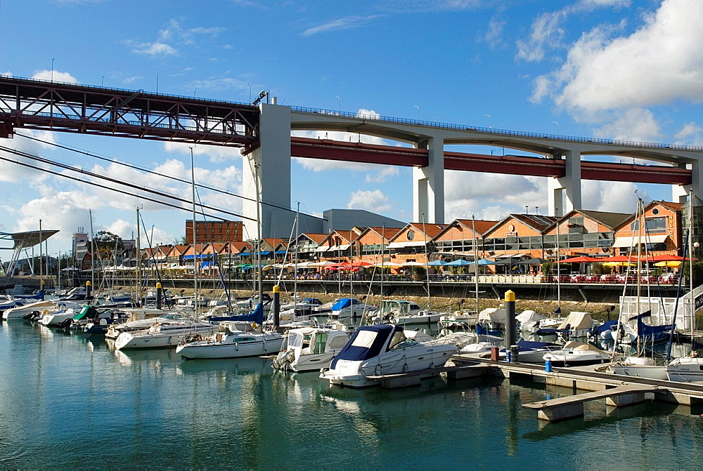 The Docks, the upscale commercial and retail district of the harbour area of Alcantara, under the 25 de Abril Bridge, Lisbon, Portugal, Europe