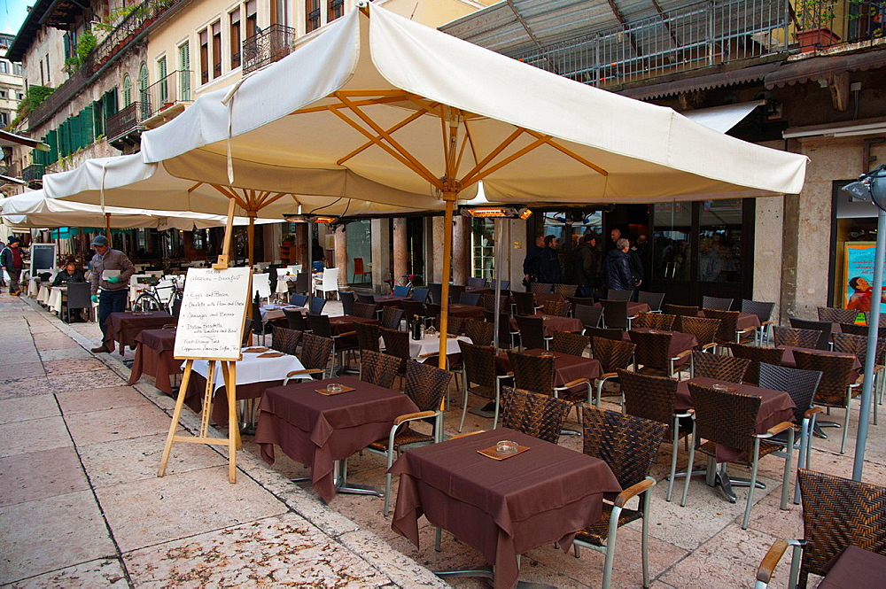 Restaurant cafe terrace Piazza delle Erbe square old town Verona city the Veneto region northern Italy Europe