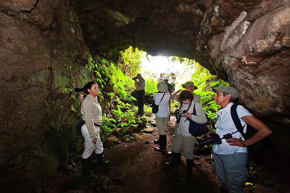 Guests from the Lindblad Expedition ship National Geographic Endeavour explore a lava tube on Santa Cruz Island in the Galapagos Islands, Ecuador