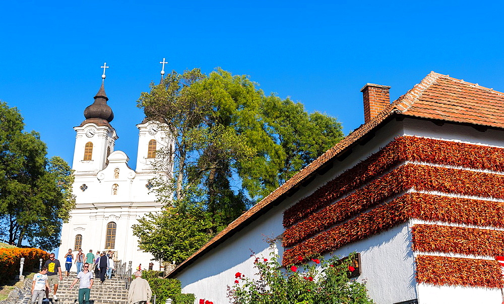 The Benedictine Abbey of Tihany is one of the main attractions of the Balaton area In the foreground the house of parika Europe, Eastern Europe, Hungary, Tihany, October