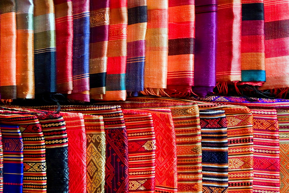 Traditional patterned silks display Luang Prabang Laos