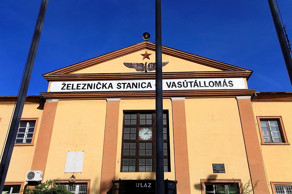 Serbia, Vojvodina, Subotica, railway station, bilingual sign, Serbian, Hungarian,