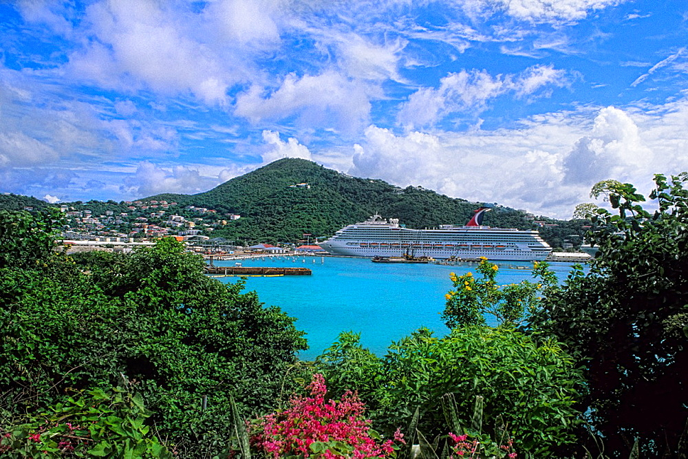 St Thomas in capital of Charlotte Amalie view from mountain showing ocean bay and Carnival Cruise Liberty at port